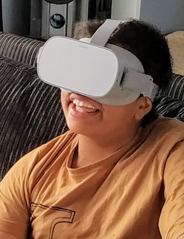 boy wears VR headset