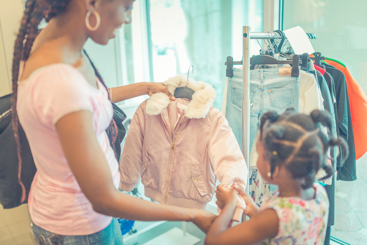 mom and daughter clothes shopping
