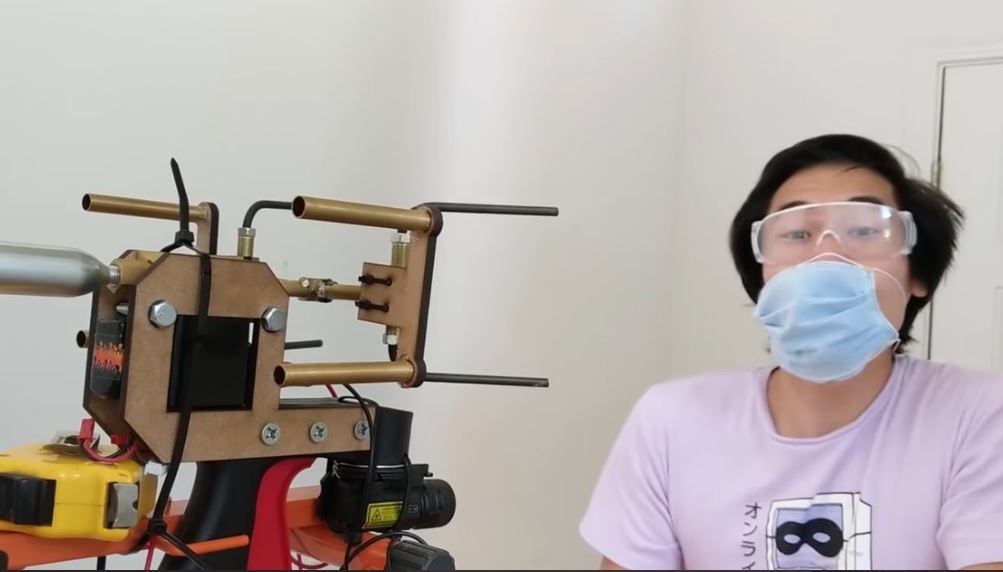 YouTuber builds device that shoots masks right onto people's faces